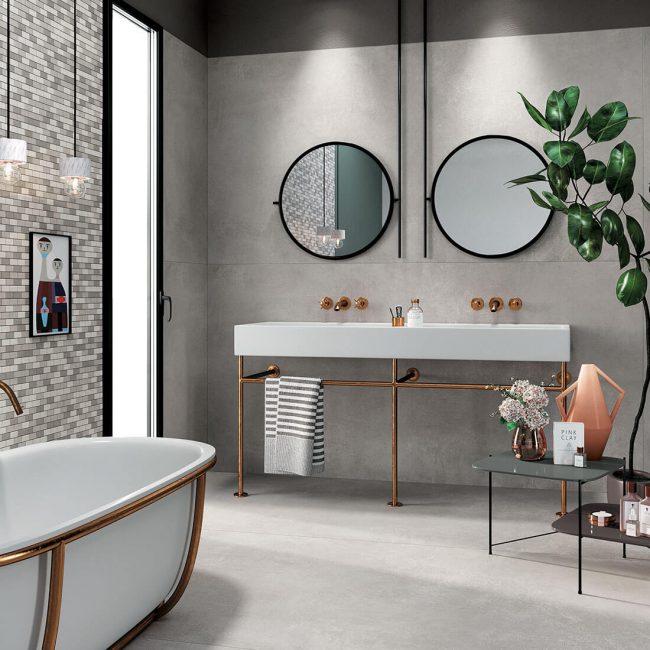 carrelage effet beton styme industriel amenagement decoration salle de bain baignoire construction maison Montagnac