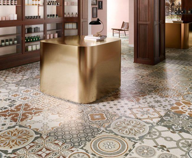 carrelage sol granito terrazzo motif carreau de ciment vieilli mix décoration boutique local Lavérune