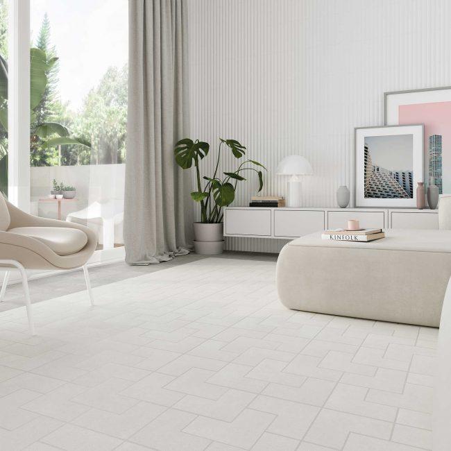 calepinage déco carrelage format original blanc effet pierre dans un salon séjour d un appartement neuf de saint jean de vedas pour un style neutre et scandinave