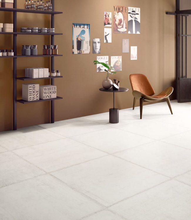 carrelage au sol authentique brut effet béton ciment banche pour un style et une décoration loft dans un appartement de Castelnau le lez