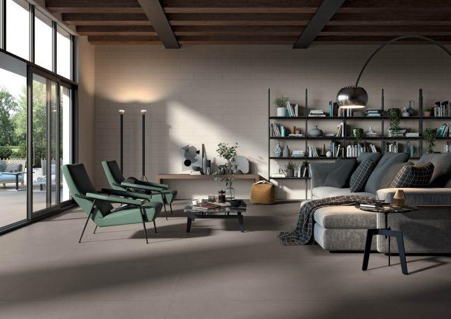 carrelage au sol d un salon séjour effet pierre béton minéral gris souris pour un style industriel chaleureux dans une maison rénovée de saint jean de cucules