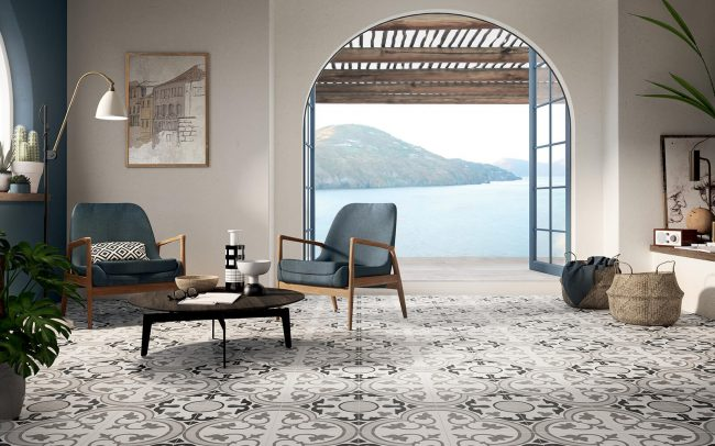 carrelage au sol effet carreaux de ciment dans un salon séjour d'une maison rénovée authentique de Cournonsec