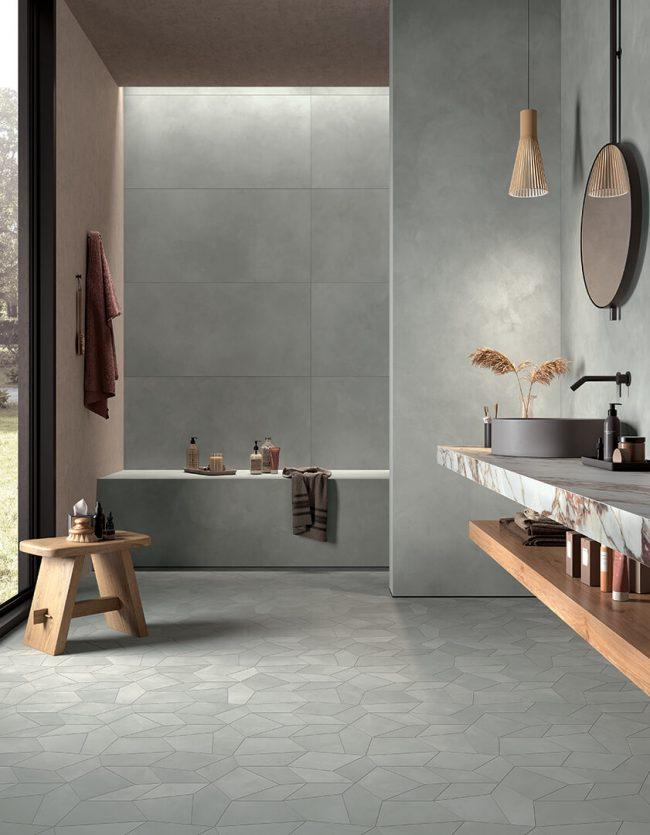 carrelage salle de bain effet béton cire gris lumineux pour une ambiance moderne épurée rénovation maison village Juvignac