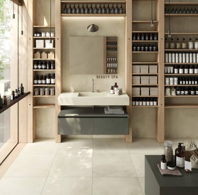 aménagement boutique meuble salle de bain vasque intégrée en grès cérame style scandinave appartement rénové de Saussan