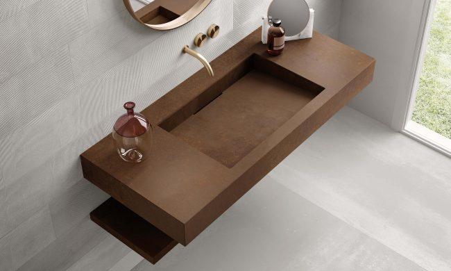 carrelage de la tour mobilier salle de bain plan de vasque intégrée grès cérame carrelage effet rouille ambiance tendance industrielle dans un appartement de Lavérune