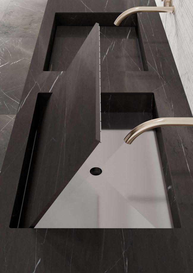 décoration d'une salle de bain avec plan vasque intégré en grès cérame pierre grise dans un appartement de lattes