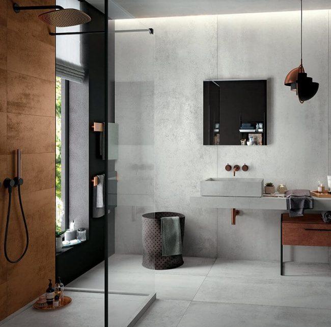 decoration d une salle de bain style industriel aveccarrelage effet metallique receveur de douche en gres cerame et vasque a poser en gres cerame dans une maison de villeneuve