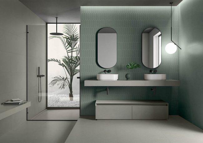 une salle de bain vert de gris avec plan vasque a poser vert de gris en grès cérame ambiance zen dans une villa de Montpellier